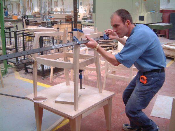 Man In Blue In Factory